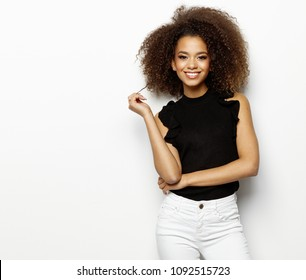 Portrait of young beautiful cute cheerful black girl smiling looking at camera over white background