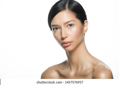 Portrait of young beautiful ethnic woman. Beauty care concept of beautiful mixed race Asian Caucasian female model  isolated on white background.