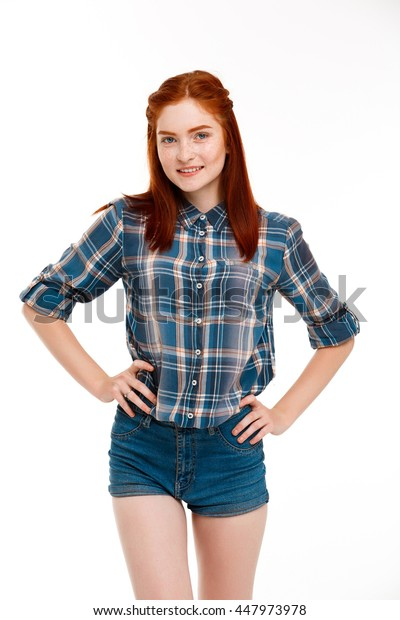 Portrait of young beautiful ginger girl over white background.