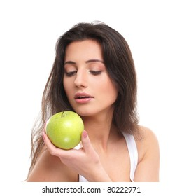 Portrait of young beautiful girl with apple isolated on white