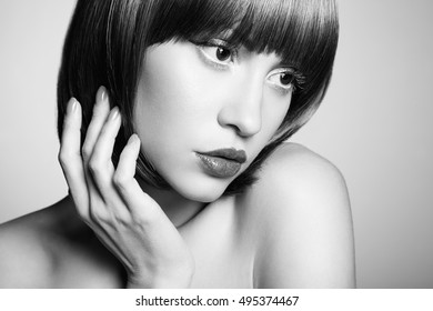 Portrait of young beautiful girl with blonde hair. Fashion photo Hairstyle. Make up. Vogue Style. Black and white photo