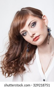 portrait of young beautiful girl with bright makeup