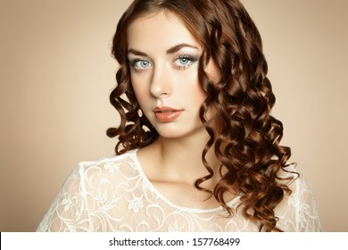 Portrait of young beautiful girl with brown hair. Fashion photo