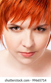 Portrait of a young beautiful girl with carroty hair on a white background