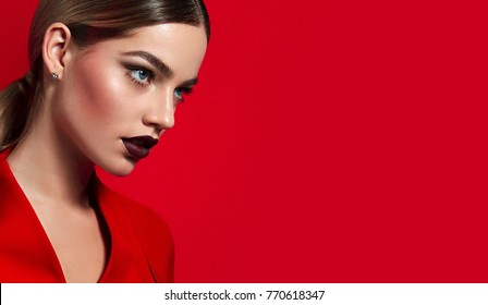 Portrait of a young beautiful girl close-up in the studio with burgundy lipstick.Fashion, beauty, make-up, cosmetics, hairstyle, beauty salon, boutique, discounts, sales.