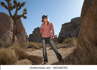 portrait of young beautiful girl in Joshua Tree park environment