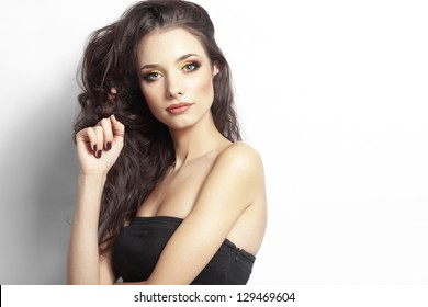 Portrait of young beautiful girl with long curly hair