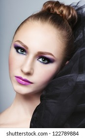 Portrait of young beautiful girl with stylish fancy make-up