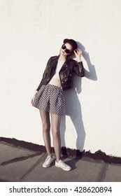 Portrait of young beautiful girl in stylish clothes. Rock woman. Fashion. Glamour. Hipster model.