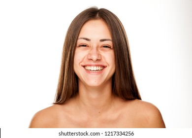 Portrait of young beautiful happy woman with no makeup on white backgeound