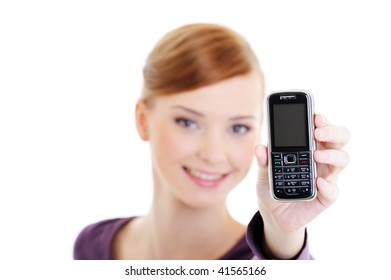 Portrait of an young beautiful happy woman on a soft focus background with mobile phone on a foreground - isolated on white