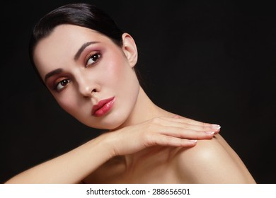 Portrait of young beautiful healthy woman with stylish make-up