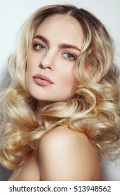 Portrait of young beautiful healthy woman with natural clean make-up and blonde curly hair