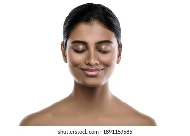 Portrait of young and beautiful Indian woman with a smooth skin on white background