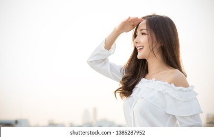 Portrait of young beautiful innocence asian woman in sky roof top. Smile face asian girl wear casual cloth. Beauty treatment perfect clear skin japanese makeup  lifestyle concept