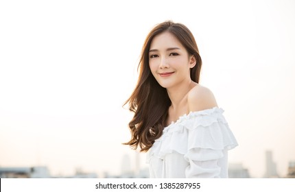 Portrait of young beautiful innocence asian woman in sky roof top. Smile face asian girl wear casual cloth. Beauty treatment perfect clear skin japanese makeup asia woman lifestyle concept
