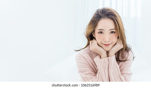 Portrait young beautiful makeup asian woman relax pink face. Smile happy asian beauty teenage girl white background banner. Makeup Japanese Chinese winter lifestyle facial treatment glow skin banner