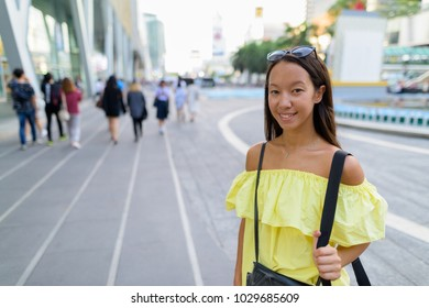 Portrait of young beautiful multi-ethnic tourist woman exploring the city of Bangkok, Thailand
