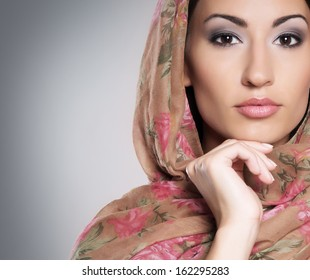 Portrait of young and beautiful orthodox woman wearing scarf on her head