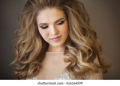Portrait of a young beautiful painted girl with a smile on her face with a magnificent hairdo