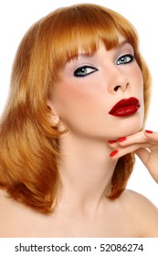 Portrait of young beautiful red-haired woman with stylish make-up