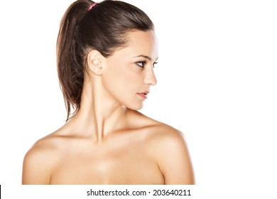 portrait of a young beautiful serious woman in profile