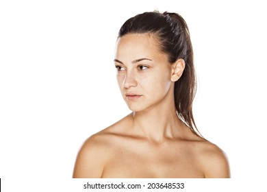 portrait of a young beautiful serious woman without make up