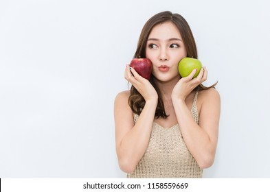 Portrait of young beautiful sexy asian girl with hands holding green and red apple that made her strong and healthy, Vegetarian woman isolated on white background healthcare and medical concept.