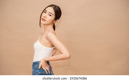 Portrait of young beautiful sexy asian korean woman slim fit body. Isolated of face fashion asian girl looking. Lifestyle japanese makeup, korea people glow skin slim fit, beauty girl next door.