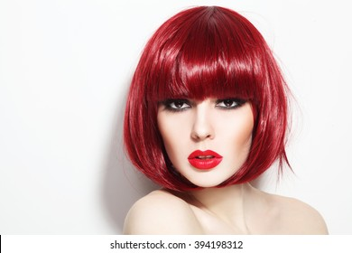 Portrait of young beautiful sexy red-haired girl with bob haircut and stylish make-up