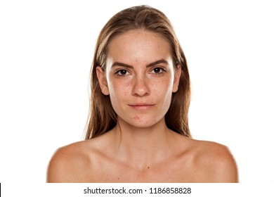 Portrait of young beautiful shirtless woman with no makeup on white backgeound