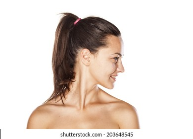 portrait of a young beautiful smiling woman without make up