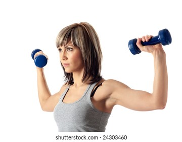 Portrait of a young beautiful sportswoman exercising with dumbbells.  Solid white background.