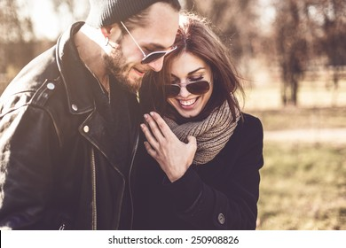 portrait of young beautiful stylish couple  in autumn park