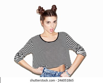 Portrait of young beautiful surprised girl. Natural makeup and top knot hairdo.