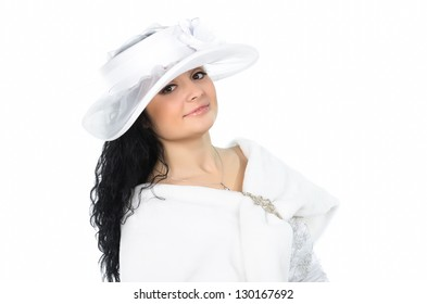 Portrait of young beautiful  white hat and white cape against white background
