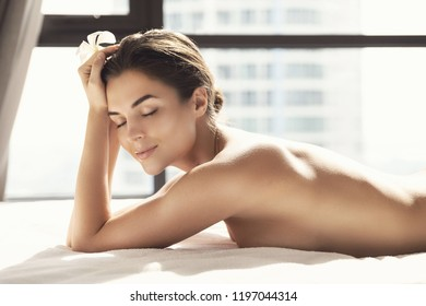 Portrait of young and beautiful woman after massage session