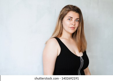 Portrait of young beautiful woman in black outfit