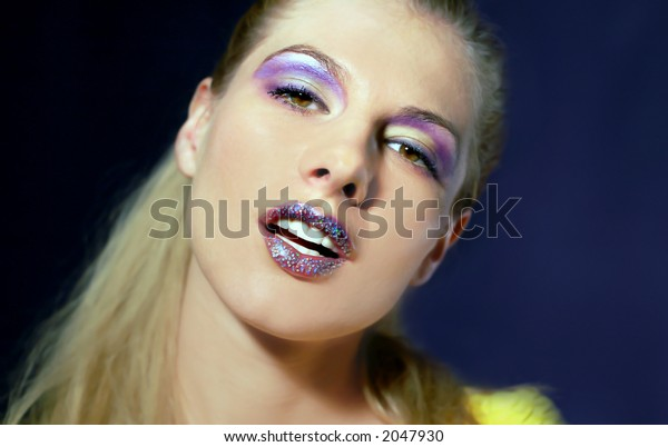 Portrait of the young beautiful woman with bright make-up