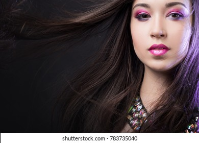 Portrait of young beautiful woman brunette with bright makeup