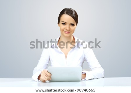 POrtrait of a young beautiful woman in business wear at work