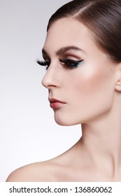 Portrait of young beautiful woman with cat eye make-up and fancy false eyelashes