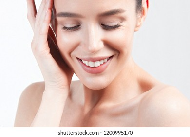 Portrait of young beautiful woman with clean perfect skin. Beauty and skin care concept