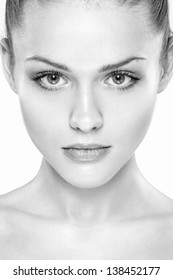 portrait of young beautiful woman with clean skin. Black and white