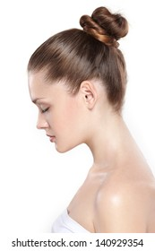 portrait of young beautiful woman with clean skin in a profile