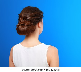 Portrait of young beautiful woman with creative elegant hairstyle