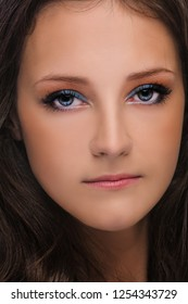 Portrait of young beautiful woman with dark hair close up.
