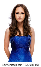 Portrait of young beautiful woman with dark hair in blue dress, isolated on white background.