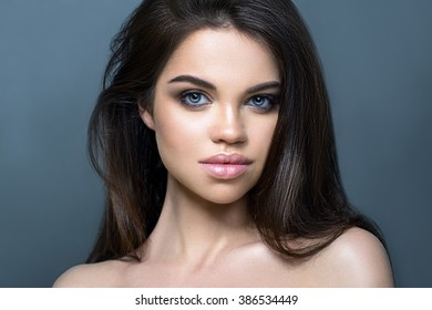 Portrait young beautiful woman with dark hair. Fashion photo.
