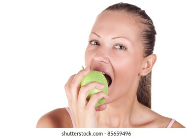 portrait of a young and beautiful woman eating green apple